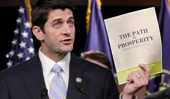 **FILE** House Budget Committee Chairman Paul Ryan, Wisconsin Republican, touts his 2012 federal budget during an April 5, 2011, news conference on Capitol Hill in Washington. (Associated Press)