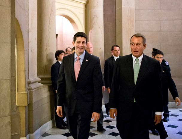 **FILE** House Speaker John Boehner (right), Ohio Republican, and Rep. Paul Ryan, Wisconsin Republican, walk in the Capitol in Washington on Sept. 13, 2012, en route to voting on a stopgap spending bill that avoids a government shutdown. (Associated Press)