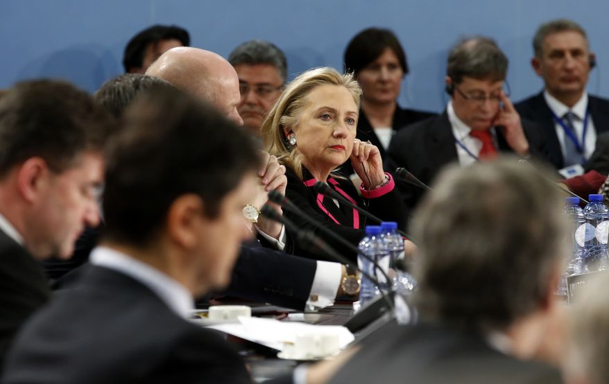 Secretary of State Hillary Rodham Clinton listens during a meeting of NATO foreign ministers at the alliance's headquarters in Brussels on Tuesday, Dec. 4, 2012. (AP Photo/Kevin Lamarque, Pool)