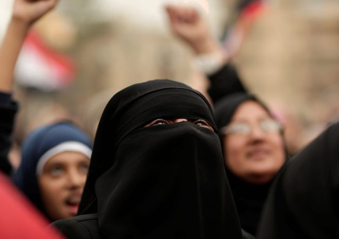Protesters chant slogans in Tahrir Square in Cairo on Dec. 4, 2012. Hundreds of black-clad riot police deployed around the Itihadiya palace in Cairo's district of Heliopolis. (Associated Press)