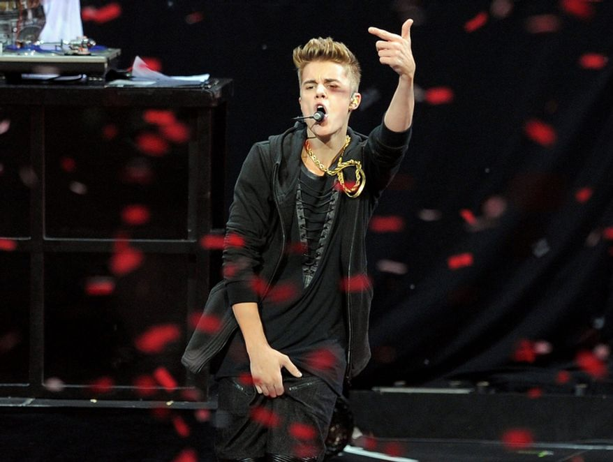 """Pop star Justin Bieber performs during the second night of KIIS-FM's """"Jingle Ball"""" at the Nokia Theatre LA Live on Monday, Dec. 3, 2012, in Los Angeles. (Chris Pizzello/Invision/AP)"""