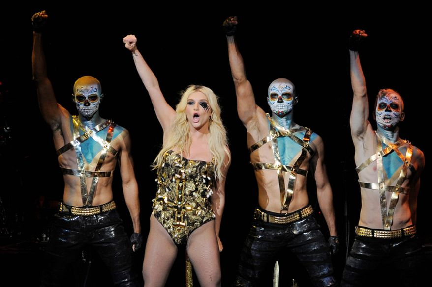 Ke$ha, second from left, performs with backup dancers during the second night of KIIS FM's Jingle Ball at Nokia Theatre LA Live on Monday, Dec. 3, 2012, in Los Angeles. (Photo by Chris Pizzello/Invision/AP)