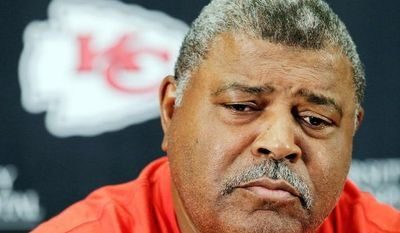 Kansas City Chiefs head coach Romeno Crennel pauses while talking about the murder-suicide committed by linebacker Jovan Belcher during a news conference on Dec. 3, 2012, at the team's practice facility in Kansas City, Mo. (Associated Press)