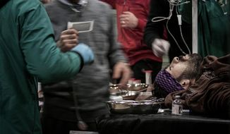 A Free Syria Army fighter receives treatment Dec. 3, 2012, at a makeshift clinic during clashes with government forces in Aleppo, Syria. (Associated Press)