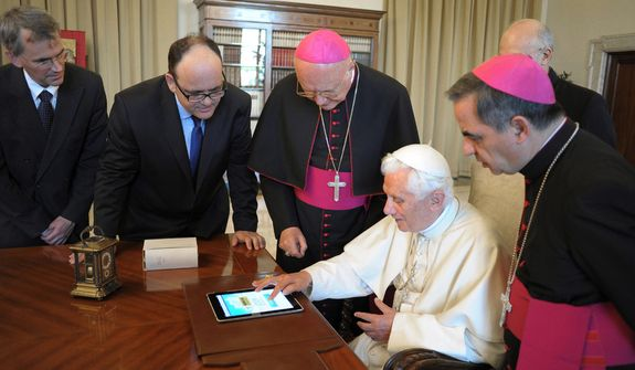 Pope Benedict XVI presses a touchpad to send a tweet for the launch of the Vatican news information portal www.news.va at the Vatican on Tuesday, June 28, 2011. (AP Photo/Osservatore Romano)