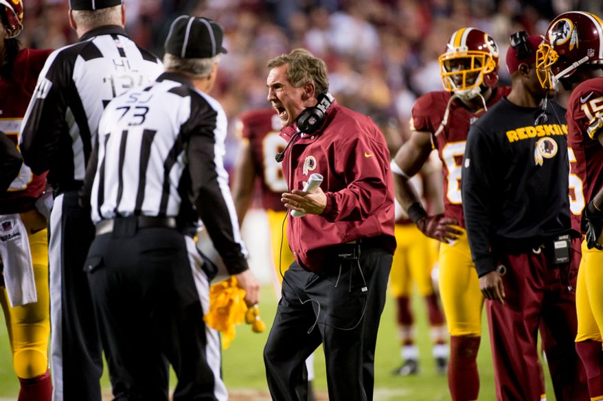 Washington Redskins head coach Mike Shanahan argues with referees after multiple unnecessary roughness penalties go against both teams on a play where Washington Redskins running back Alfred Morris (46) fumbles in the third quarter as the Washington Redskins play the New York Giants on Monday Night Football at FedEx Field, Landover, Md., December 3, 2012. (Andrew Harnik/The Washington Times)