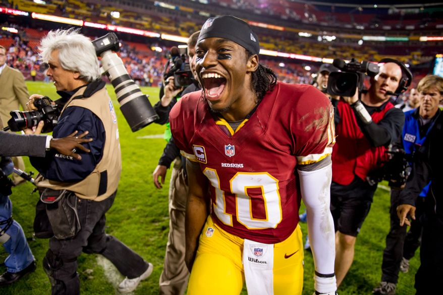 Washington Redskins quarterback Robert Griffin III (10) celebrates after the Washington Redskins defeat the New York Giants 17-16 on Monday Night Football at FedEx Field, Landover, Md., Dec. 3, 2012. (Andrew Harnik/The Washington Times)