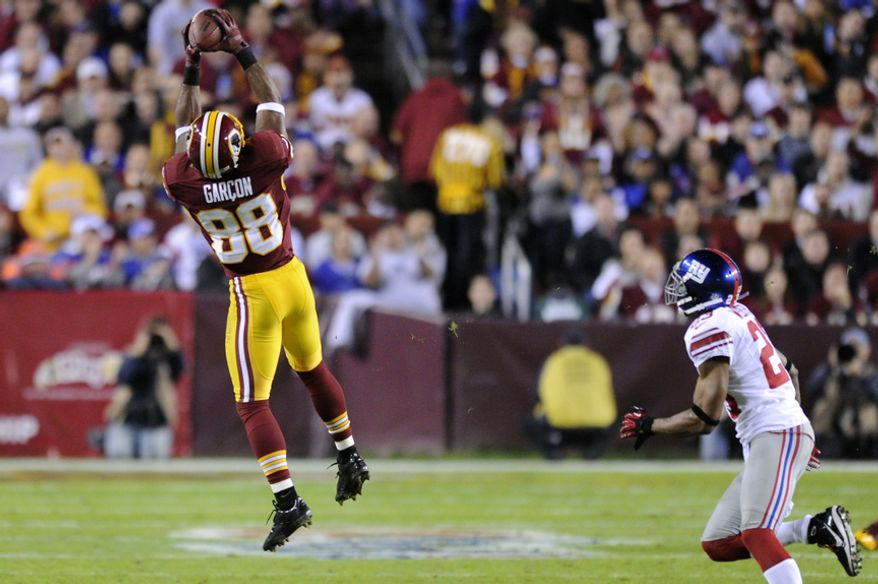 Washington Redskins wide receiver Pierre Garcon (88) hauls in a first down reception in front of New York Giants cornerback Corey Webster (23) in the first quarter at FedEx Field, Landover, Md., Dec. 3, 2012. (Preston Keres/Special to The Washington Times)