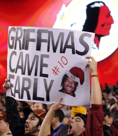 Fans celebrate their early Christmas present with a victory over the Giants at FedEx Field, Landover, Md., Dec. 3, 2012. (Preston Keres/Special to The Washington Times)