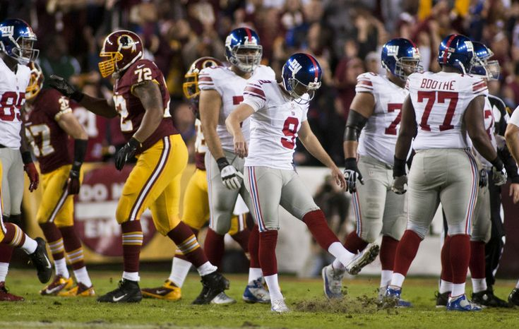 New York Giants kicker Lawrence Tynes (9) reacts after missing a field goal in the first half against the Washington Redskins, Landover, Md., Monday, December 3, 2012.  (Craig Bisacre/The Washington Times)