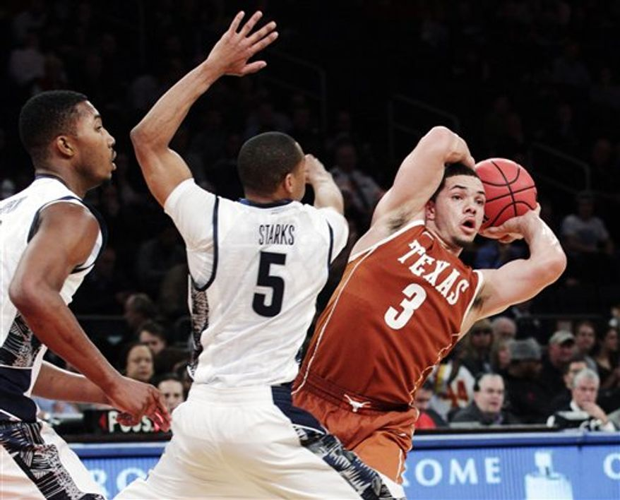 Texas' Javan Felix (3) looks to pass away from Georgetown's Markel Starks (5) during the second half of their NCAA college basketball game in the Jimmy V Classic at Madison Square Garden, Tuesday, Dec. 4, 2012, in New York. Georgetown won 64-41. (AP Photo/Frank Franklin II)