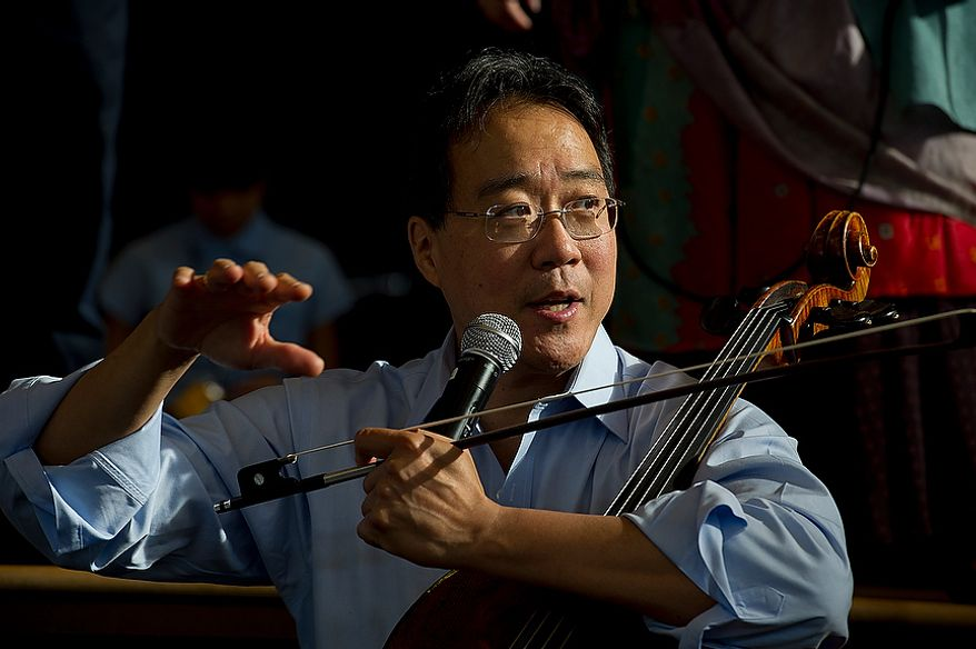World renowned cellist Yo Yo Ma talks to students at Savoy Elementary School in Southeast Washington, D.C. during a performance on Tuesday, Dec. 4, 2012. Mr. Ma came to the school as part of the Innovative Schedule for the Arts, a new program started up at the school only a couple of months ago that integrates the arts into students' everyday schedules. (Barbara L. Salisbury/The Washington Times)