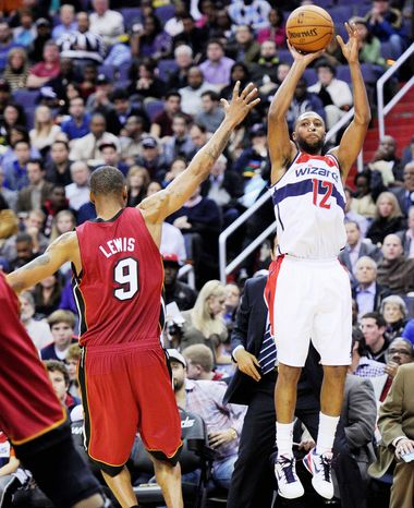 Wizards guard A.J. Price prepares to release a shot against Heat forward Rashard Lewis during Washington's 105-101 win Tuesday night at Verizon Center. (Associated Press)