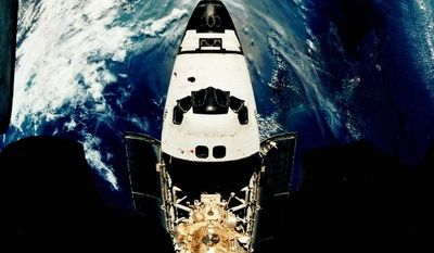 Space Shuttle Atlantis, here in 1995, is docked with the Russian space station Mir as the two spacecraft orbit the Earth. NASA looks lost in space and without a clear sense of where the agency is going, an independent panel of science and engineering experts said in a critical report released Wednesday. (NASA via Associated Press)