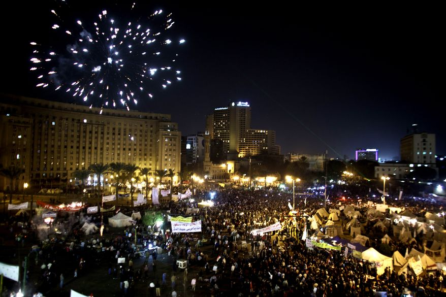Fireworks burst over Tahrir Square as demonstrators gather in Cairo on Tuesday, Dec. 4, 2012, to protest Islamist President Mohammed Morsi's seizure of nearly unrestricted powers. (AP Photo/Maya Alleruzzo)