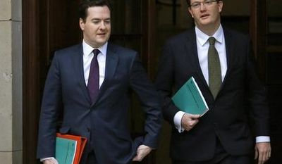 George Osborne (left), Britain's Chancellor of the Exchequer, walks with Danny Alexander, Chief Secretary to the Treasury, to deliver the half-yearly budget statement to parliament in London on Dec. 5, 2012. (Associated Press)