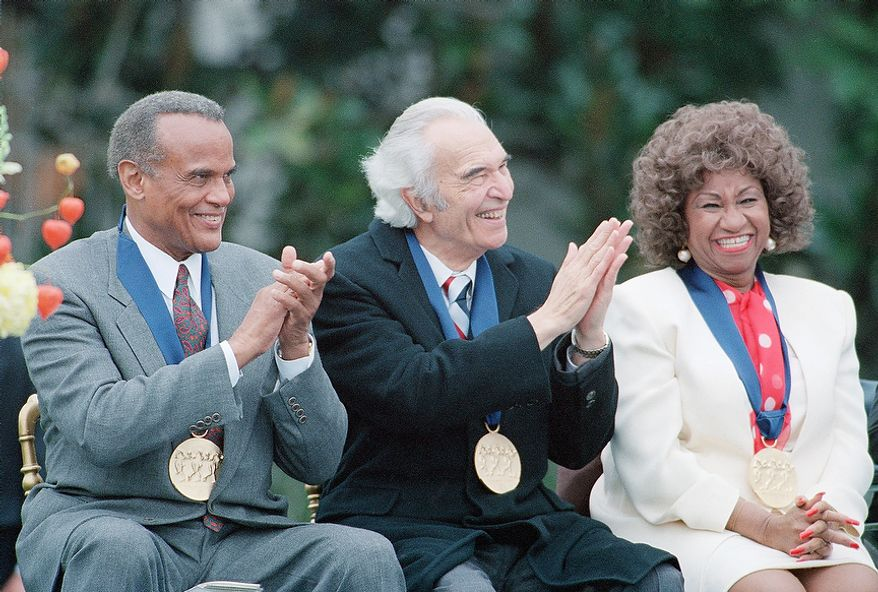 Actor-singer Harry Belafonte left, jazz musician and composer Dave Brubeck, center, and singer Celia Cruz, at the White House Friday, Oct. 14, 1994, Washington, DC. They received 1994 National Medals of Arts. (AP Photo/Joe Marquette)