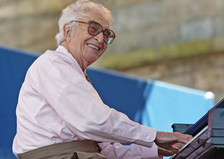Dave Brubeck and his quartet perform at the JVC Jazz Festival in Newport, R.I., Sunday, Aug. 13, 2006. Fans enjoyed jazz acts on three stages set around the Fort Adams waterfront during the third day of the three day festival. (AP Photo/Stew Milne)