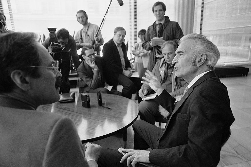 American jazz pianist Dave Brubeck, right, shown at a press conference prior to his appearance before a Soviet audience, Thursday, March 26, 1987, Moscow, Russia. (AP Photo/Boris Yurchenko)