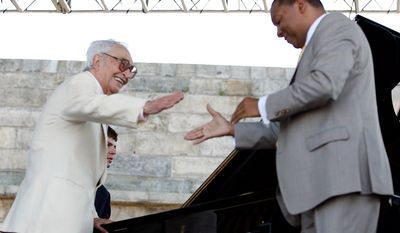 Wynton Marsalis, right, greets Dave Brubeck as he joins him on stage during Marsalis's set  at the CareFusion Newport Jazz Festival on Sunday, Aug. 8, 2010 in Newport, R.I.  (AP Photo/Joe Giblin)