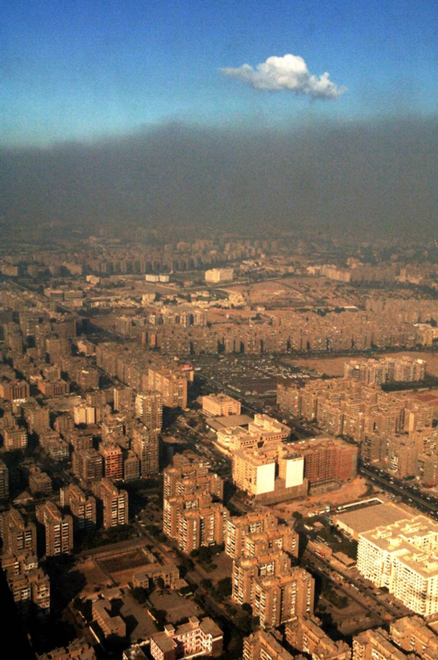 In this Sunday, Oct. 29, 2006 file photo, smog covers the city of Cairo, Egypt, where 2,000,000 cars on the streets and many unregistered lead and copper smelters heavily pollute. The Quran, Islam's holy book, is filled with more than 1,500 verses to nature and Earth. Yet the voice of Islamic leaders is missing from the global dialogue on warming. (AP Photo/Geert Vanden Wijngaert, File)