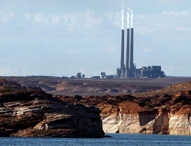 In this Sept. 4, 2011 file photo shows the main plant facility at the Navajo Generating Station, from Lake Powell, in Page, Ariz. The United Nations climate chief is urging people not to look solely to their governments to make tough decisions to slow global warming, and instead to consider their own role in solving the problem. (AP Photo/Ross D. Franklin, File)