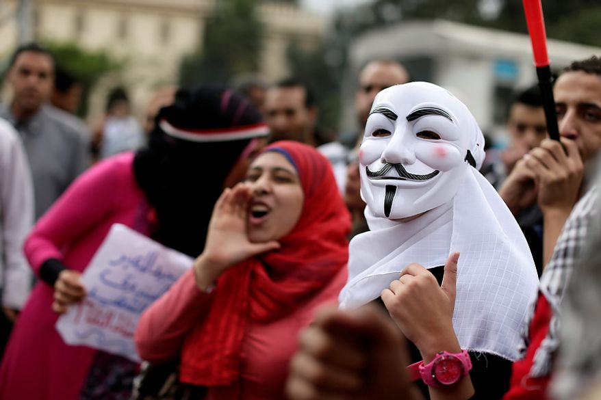 Egyptian protesters chant anti Muslim Brotherhood slogans during a demonstration outside the presidential palace, in Cairo, Egypt, Wednesday, Dec. 5, 2012. Egyptian  (AP Photo/Hassan Ammar)
