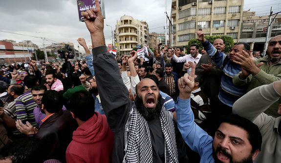 A supporter of Egyptian President Mohammed Morsi chants slogans during clashes with opponents, not pictured, outside the presidential palace, in Cairo, Egypt, Wednesday, Dec. 5, 2012.  (AP Photo/Hassan Ammar)