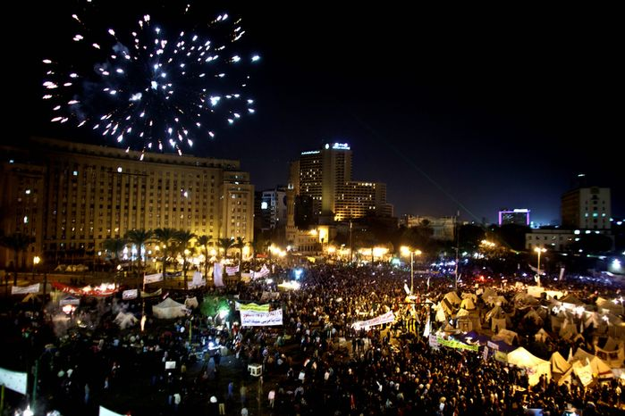 Fireworks burst over Tahrir Square as protesters gather in Cairo on Dec. 4, 2012. Demonstrations by tens of thousands of Egyptians outside the presidential palace turned violent as tensions grew over Islamist President Mohammed Morsi's seizure of nearly unrestricted powers. Thousands of protesters also gathered in Cairo's downtown Tahrir Square, miles away from the palace, to join several hundred who have been camping out there for nearly two weeks. (Associated Press)