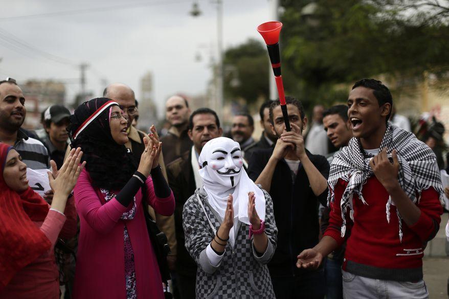 Egyptian protesters chant anti-Muslim Brotherhood slogans outside the presidential palace in Cairo on Wednesday, Dec. 5, 2012. (AP Photo/Hassan Ammar)
