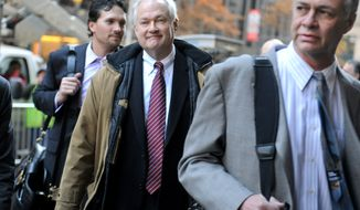 NHL Players' Association executive director Donald Fehr, center, arrives for labor talks at NHL headquarters in New York with his brother, NHLPA counsel Steven Fehr, right, Wednesday, Nov. 21, 2012, in New York. (AP Photo/ Louis Lanzano)