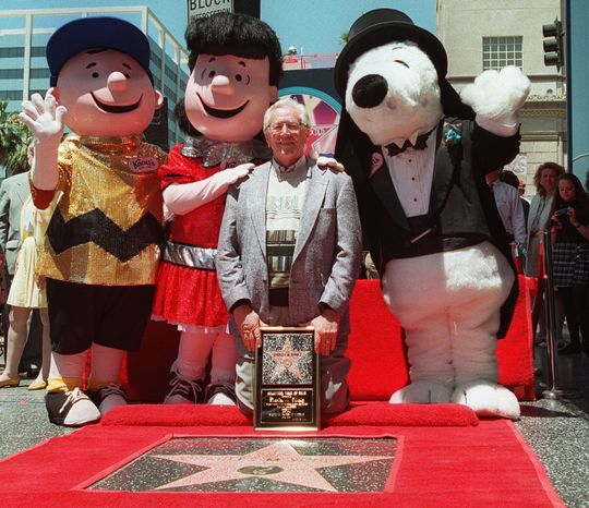 """""""Peanuts"""" creator Charles M. Schulz is joined by his characters (left to right) Charlie Brown, Lucy and Snoopy after his star was unveiled on the Hollywood Walk of Fame in the Hollywood section of Los Angeles on Friday, June 28, 1996. """"Pretty good for a cartoonist,"""" Schulz said. (AP Photo/Susan Sterner)"""