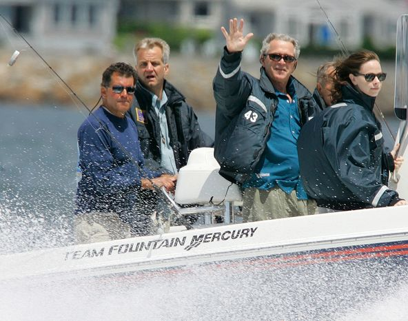 President George W. Bush waves as he stands next to his daughter Barbara as they pass by on his father's, former President George Bush, fishing boat Fidelity III, off the coast of Kennebunkport, Maine, on Saturday morning, June 30, 2007. Former President Bush pilots his boat as a Secret Service agent and his fishing guide, Billy Bush (left), stand behind. (AP Photo/Stephan Savoia)