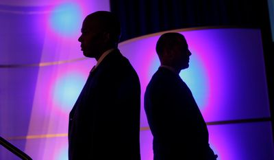 U.S. Secret Service agents stands watch as Republican presidential candidate Mitt Romney addresses the U.S. Hispanic Chamber of Commerce in Los Angeles on Monday, Sept. 17, 2012. (AP Photo/Charles Dharapak)