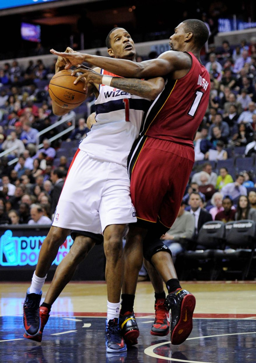 Washington Wizards forward Trevor Ariza (1) drives to the basket against Miami Heat center Chris Bosh (1) during the second half of an NBA basketball game, Tuesday, Dec. 4, 2012, in Washington. The Wizards won 105-101. (AP Photo/Nick Wass)