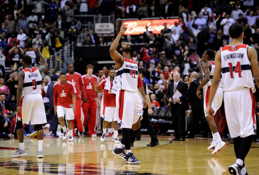 Washington Wizards center Nene (42) of Brazil, and Martell Webster (9) react at the close of an NBA basketball game against the Miami Heat, Tuesday, Dec. 4, 2012, in Washington. The Wizards won 105-101. (AP Photo/Nick Wass)