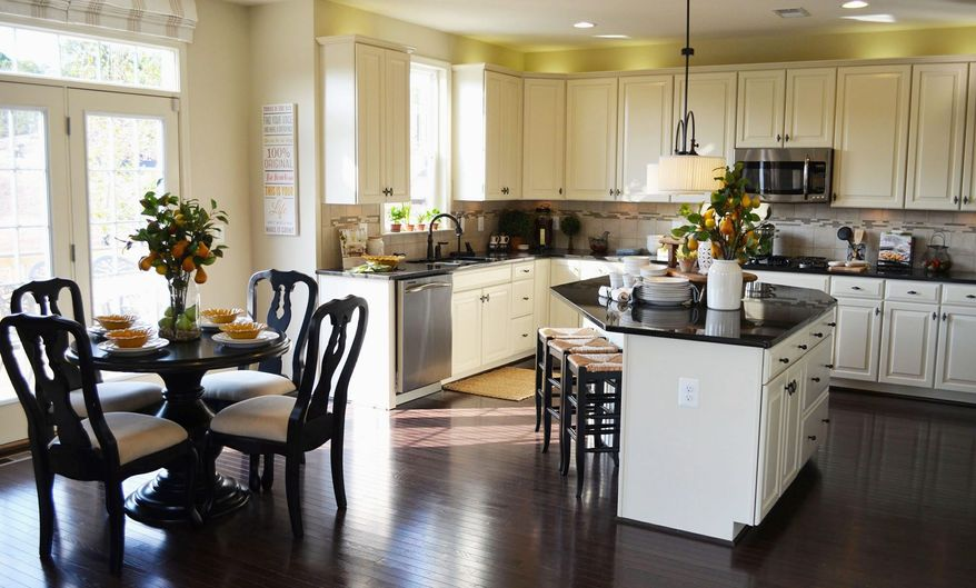 The kitchen in the Manchester model has a center island and granite counters.