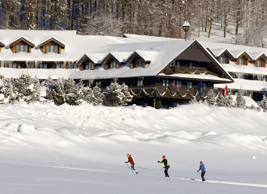 Cross-country skiers pass by the Trapp Family Lodge near Stowe, Vt., in an undated photo. (Associated Press)