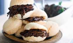 ** FILE ** Sweet-and-tangy barbecue brisket is a delicious filler for sliders. (Associated Press)