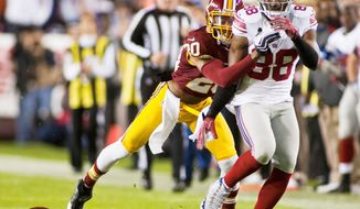 Redskins cornerback Cedric Griffin (left) was suspended four games for using Adderall. (Craig Bisacre/The Washington Times)