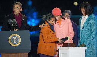 President Obama, with (from left) daughters Sasha and Malia, mother-in-law Marian Robinson and wife Michelle, officiates at the lighting of the National Christmas Tree on the Ellipse. (Andrew Harnik/The Washington Times)