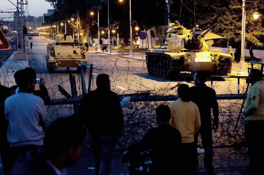 Egyptian tanks help secure the presidential palace in Cairo during a protest Thursday by opponents of President Mohammed Morsi. Egypt has the largest army in Africa and the seventh-largest tank army in the world, in part because of U.S. military aid. (Associated Press)