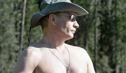 ** FILE ** Russian President Vladimir Putin strips off his shirt while fishing in the Siberian mountains in 2007. (Associated Press)