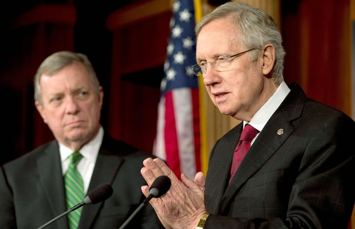 Senate Majority Leader Harry Reid (right) of Nevada, seen here Thursday with fellow Democratic Sen. Richard J. Durbin of Illinois, ridiculed his Republican counterpart for flip-flopping on a measure to give the president more debt-ceiling authority. (Associated Press)