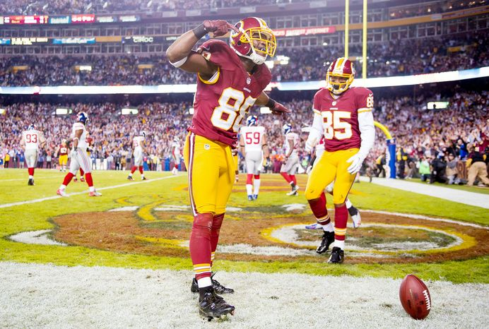 Receiver Pierre Garcon (88) has scored touchdowns in each of the past two games, including this one against the Giants on Monday night. (Andrew Harnik/The Washington Times)