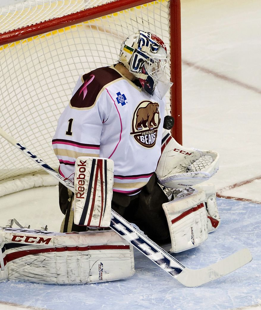 Hershey Bears goalie Braden Holtby (1) makes one of his 40 saves in the first period of their AHL hockey game against the Toronto Marlies, Sunday, Nov. 25, 2012, in Hershey, Pa. The Bears won 4-2. (AP Photo/Lebanon Daily News, Glen Gray) THE PATRIOT-NEWS OUT.