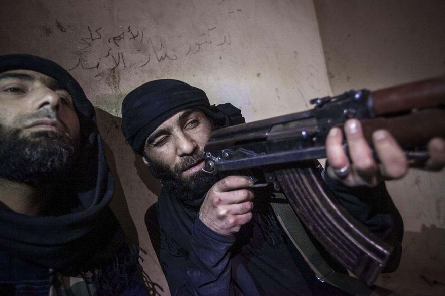 A Free Syrian Army fighter aims his weapon during heavy clashes with government forces in Aleppo, Syria, on Wednesday, Dec. 5, 2012. (AP Photo/Narciso Contreras)