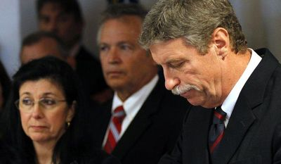Jim Letten, U.S. attorney for the Eastern District of Louisiana, announces his resignation during a news conference in New Orleans on Thursday, Dec. 6, 2012. His wife, JoAnn, is second from left. (AP Photo/Gerald Herbert)
