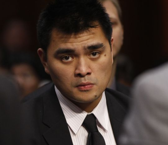 **FILE** Jose Antonio Vargas, Pulitzer Prize winning journalist and immigration reform activist, listens June 28, 2011, as Homeland Security Secretary Janet Napolitano and Education Secretary Arne Duncan testify at a hearing regarding immigration reform and the DREAM Act on Capitol Hill in Washington. (Associated Press)