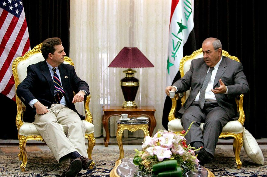 Iraqi Interim Prime Minister Ayad Allawi (right) and U.S. Sen. Jim DeMint, South Carolina Republican, meet in Baghdad on Sunday, Feb. 27, 2005. A delegation of visiting U.S. senators and representatives met with Mr. Allawi, though no statement was made to the media. (AP Photo/Karim Sahib, Pool)